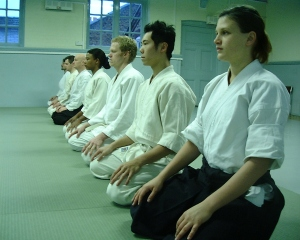 Members of Tetsushinkan Dojo sitting in seiza